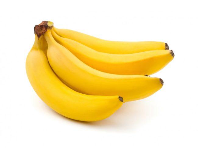 Жёлтые бананы на белом фоне