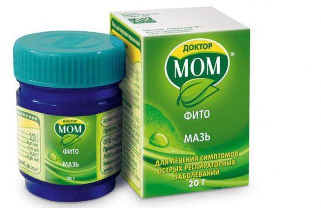 """На белом фоне зелёная упаковка с лекарственным средством в синей баночке """"Доктор МОМ"""""""